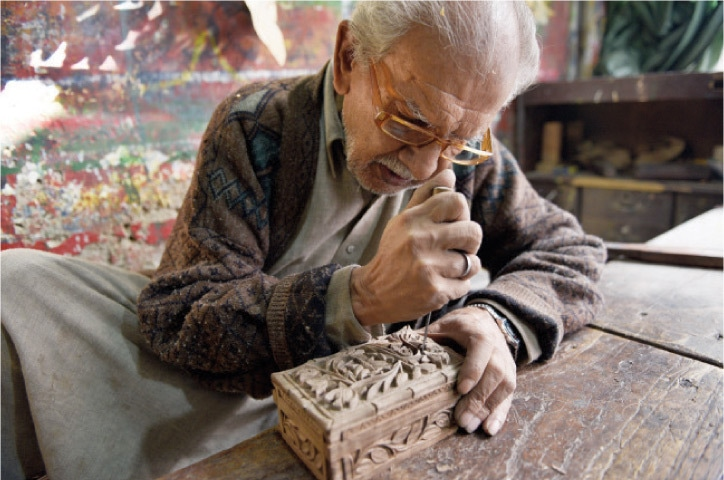 Hamid Ali, 65, makes a traditional Kashmiri jewellery box made of walnut wood. Typical carvings include chinnar leaves and lotus flowers, and the work is only carried out in bright daylight.