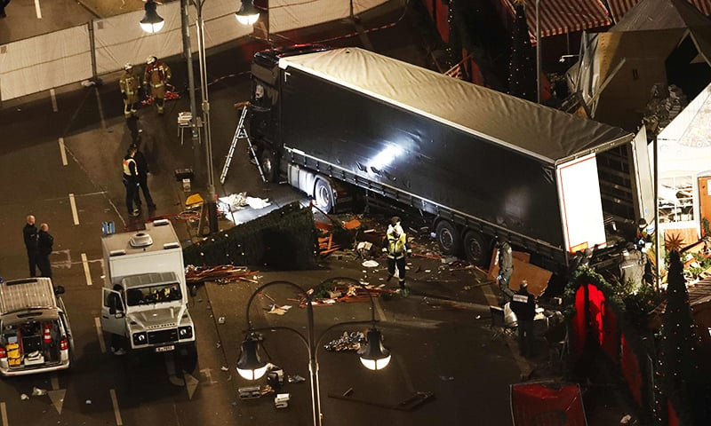 Authorites inspect a truck that had sped into a Christmas market in Berlin, on Dec 19, 2016.— AFP
