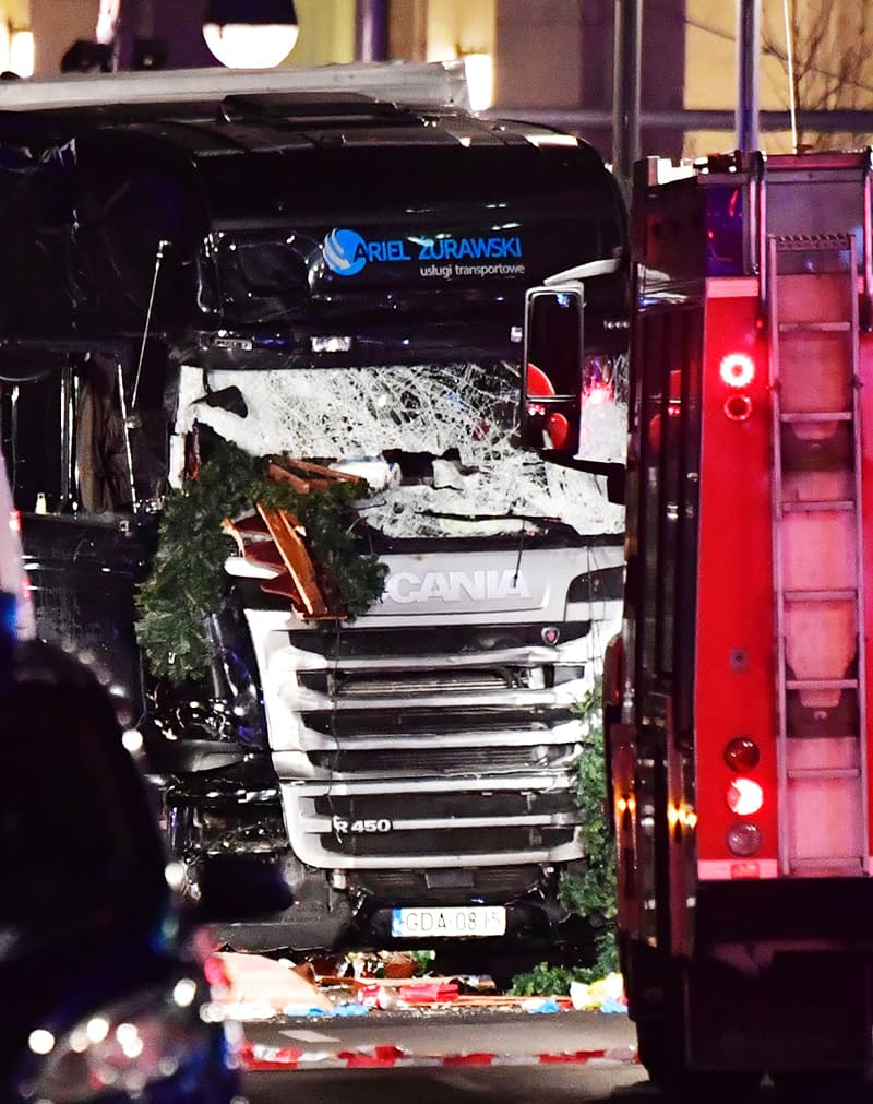 The broken front window is pictured of the truck. — AFP