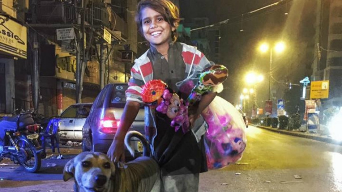 This photographer's viral photo is helping fund a homeless kid and his pet dog