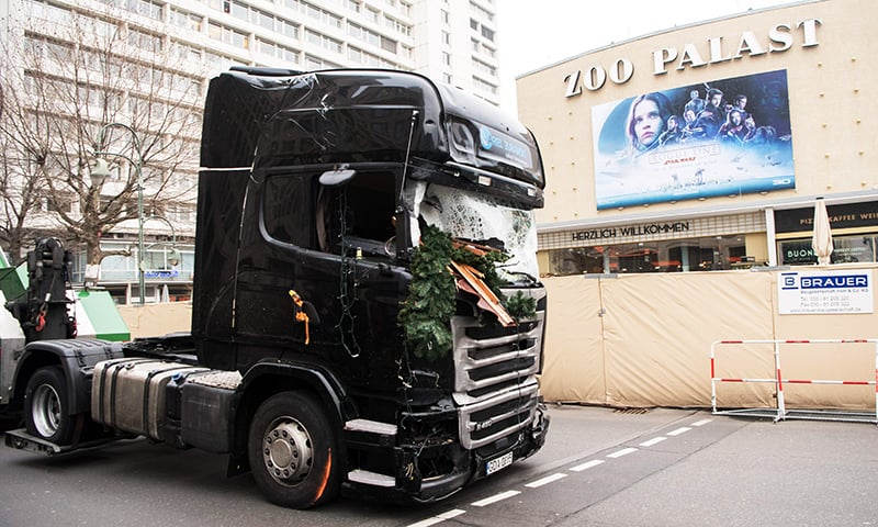 The cabin of a truck is pulled off the Christmas market past the Zoopalast cinema. -AFP