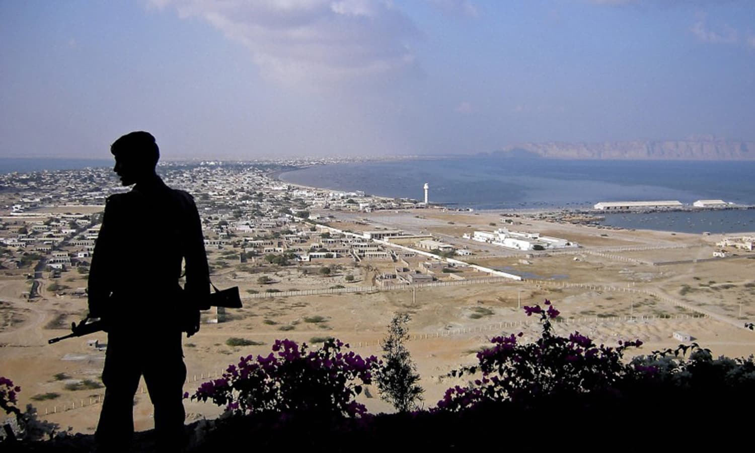 A Pakistani soldier stands on top of a hill in Gwadar. Parts of Balochistan have often been hit by a Baloch nationalist insurgency and also by violence from extremist groups. (Picture: The Guardian)