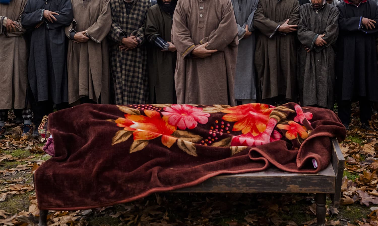 Kashmiri mourners offer prayers during the funeral of Rasiq Ahmed Khan. ─AFP