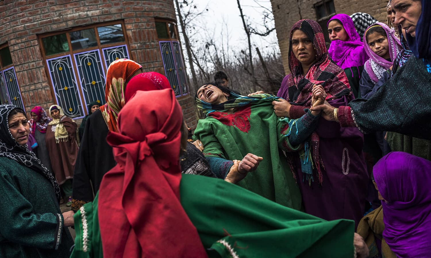 Hafeeza Khan (C), weeps during the funeral of nephew Rasiq Ahmed Khan, aged around 22, and who was found shot to death, at their home. ─AFP