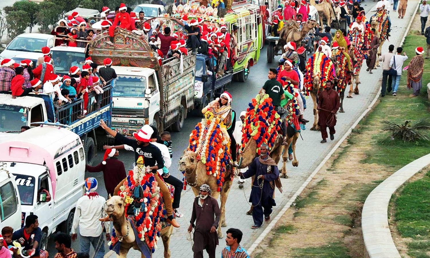 Members of Karachi's Christian community ride camels at a rally held in connection with Christmas.  — Online
