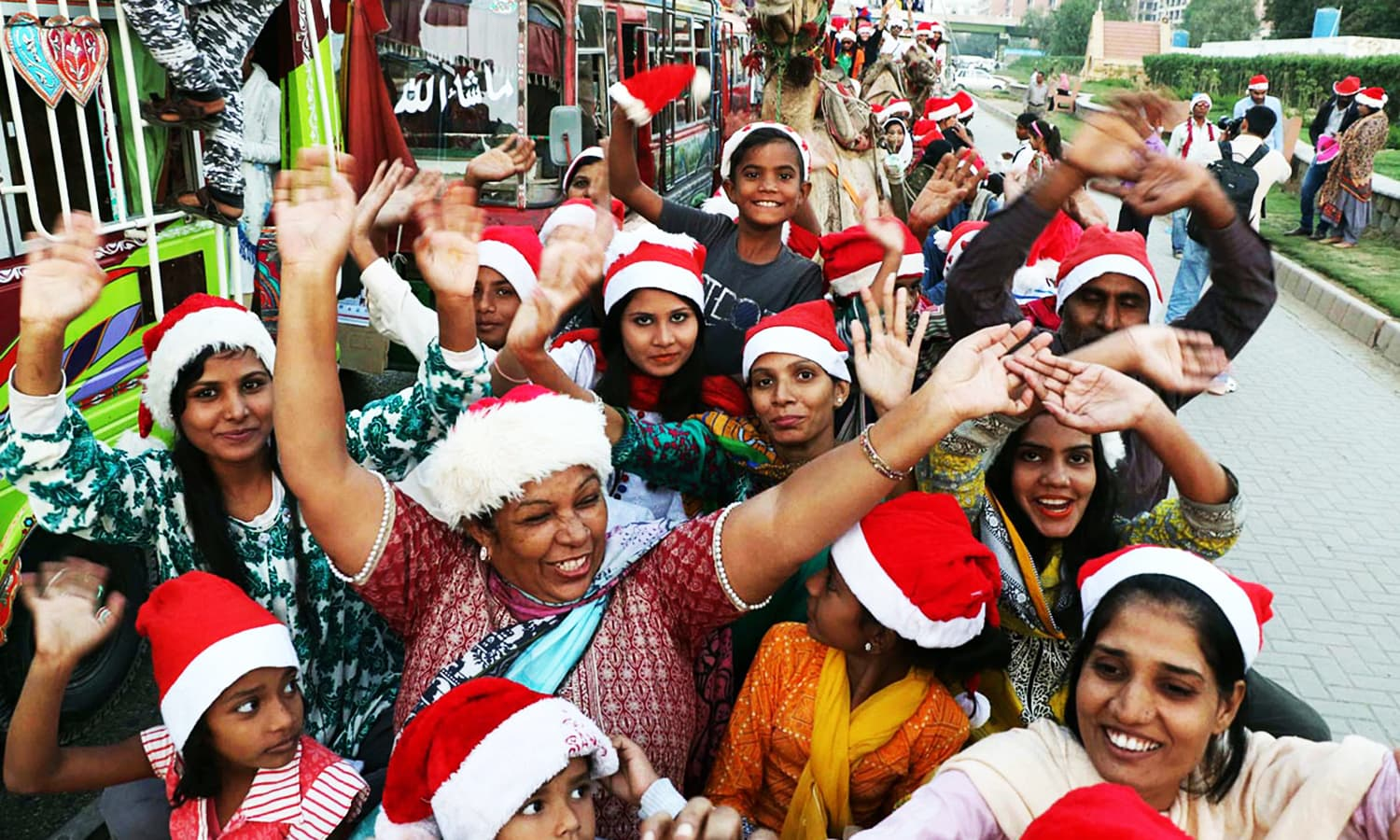 Women dance on the street during the Christmas rally. — Online