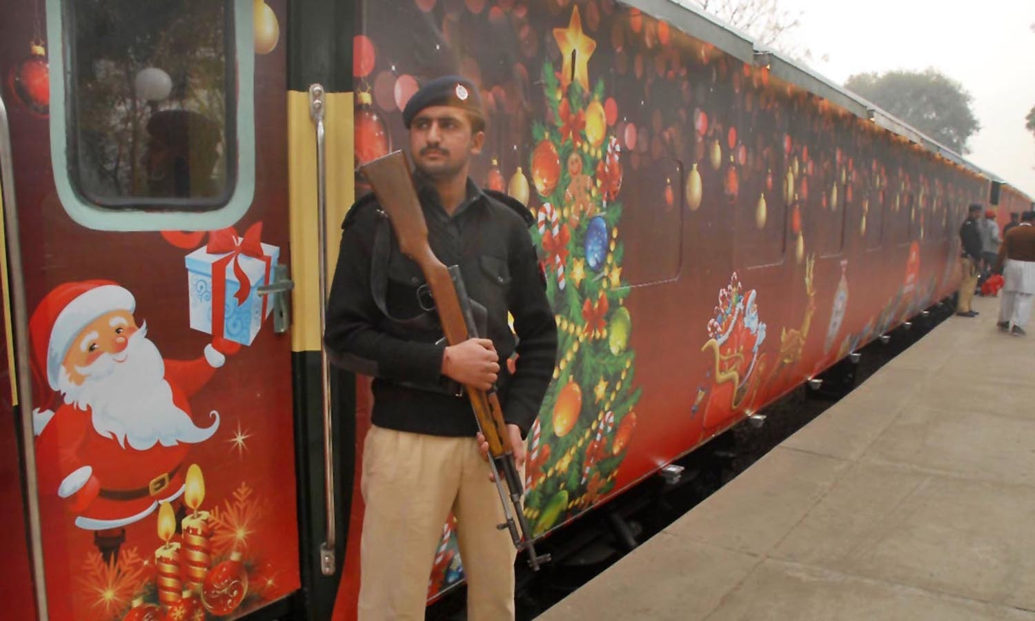 Policeman standing alert to avert any untoward incident during inauguration of Christmas train at Islamabad Railway Station ahead of Xmas.─APP