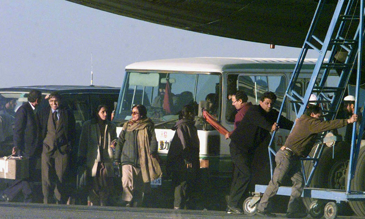 Freed passengers of the hijacked plane prepare to board a minibus | Reuters)