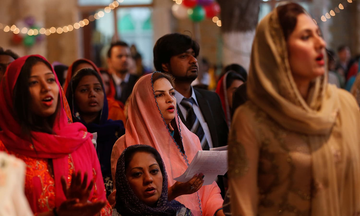 People pray as they gather for a ceremony on Christmas eve at Central Brooks Memorial Church in Karachi. ─Reuters
