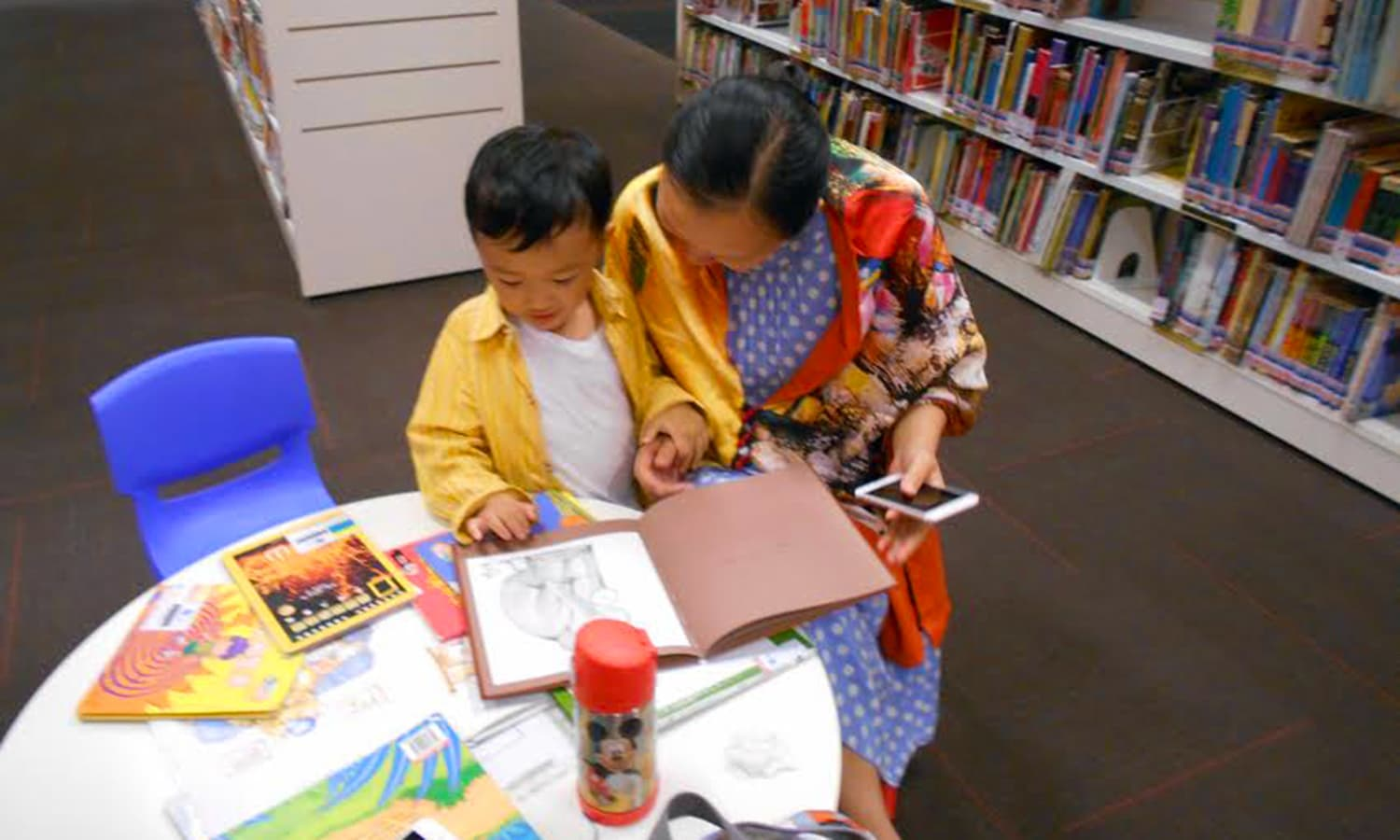 what my to a public library in singapore made me realise a grandmother introduces the pleasure of reading to the tiny tot