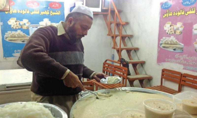 A Kheer seller in Qissa Khawani Bazaar. — Dawn