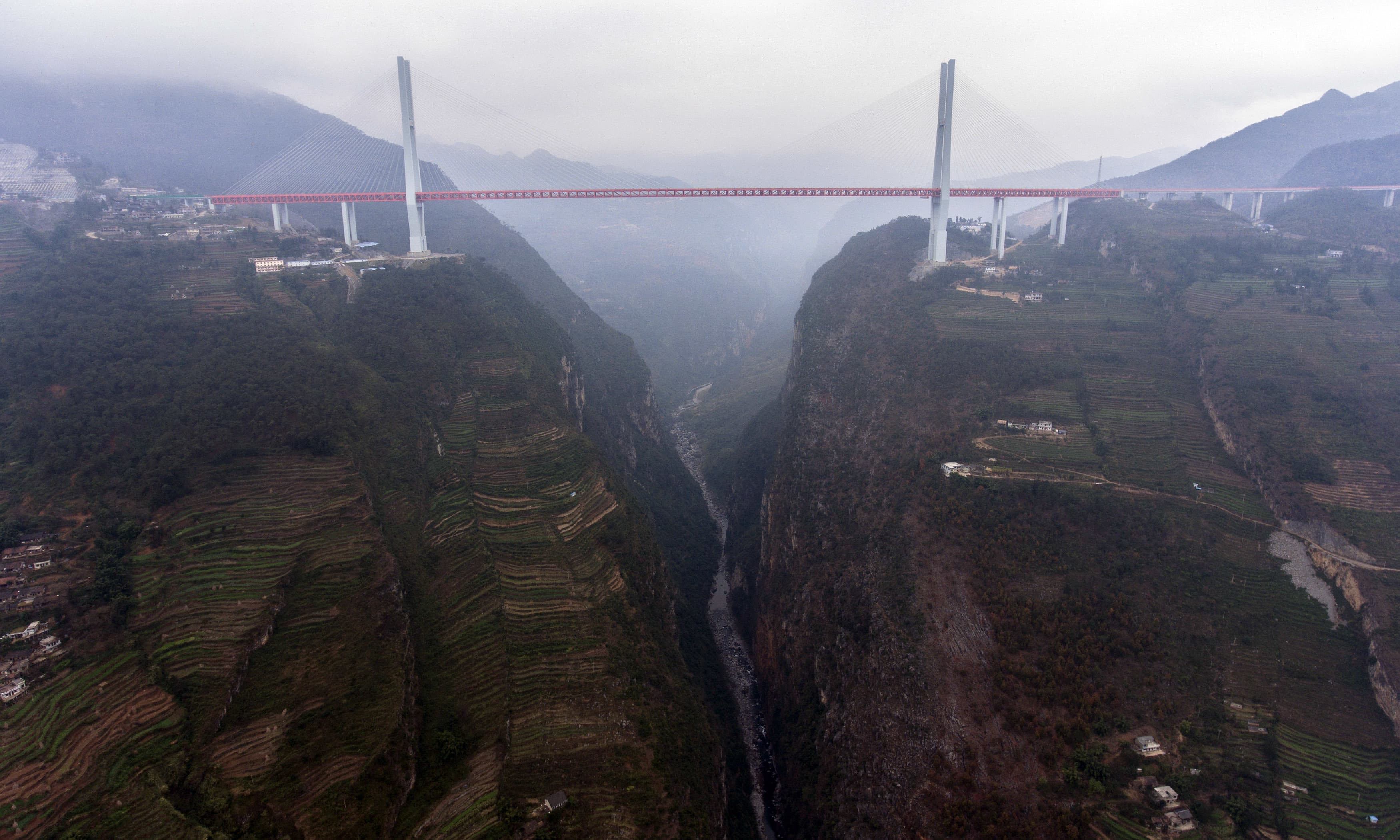 An aerial view of the completed Beipanjiang Bridge across the Beipanjiang valley is seen in Shuicheng county.—AP