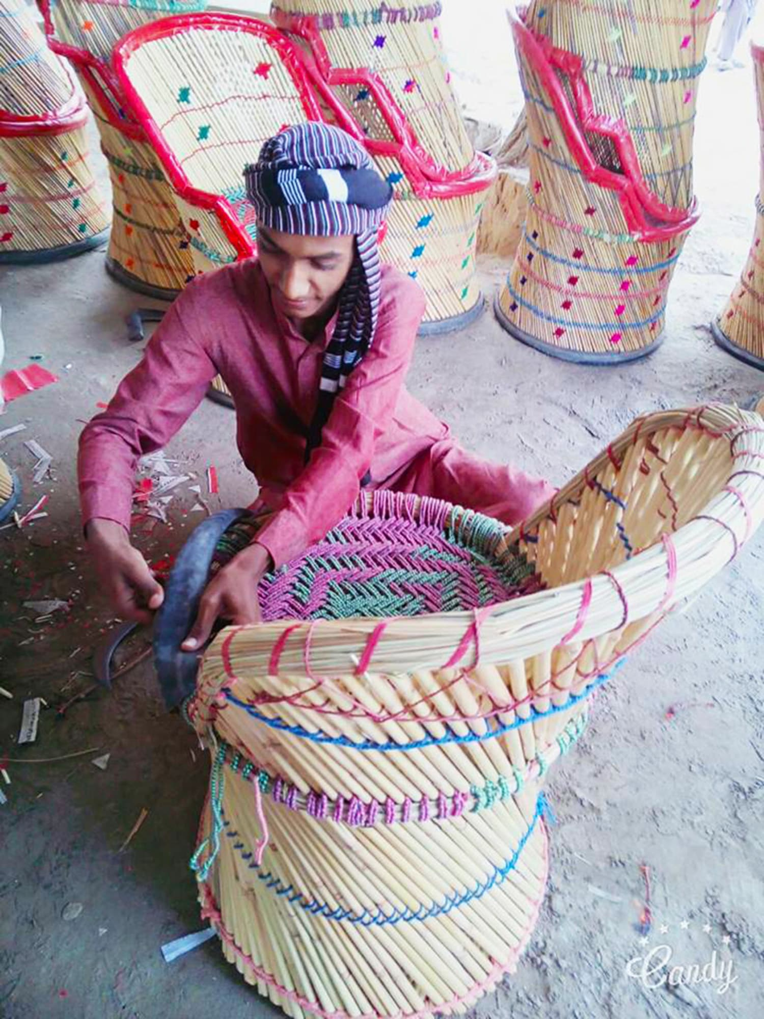 An young boy making a colourful chair, known as *moorho* in Sindhi.