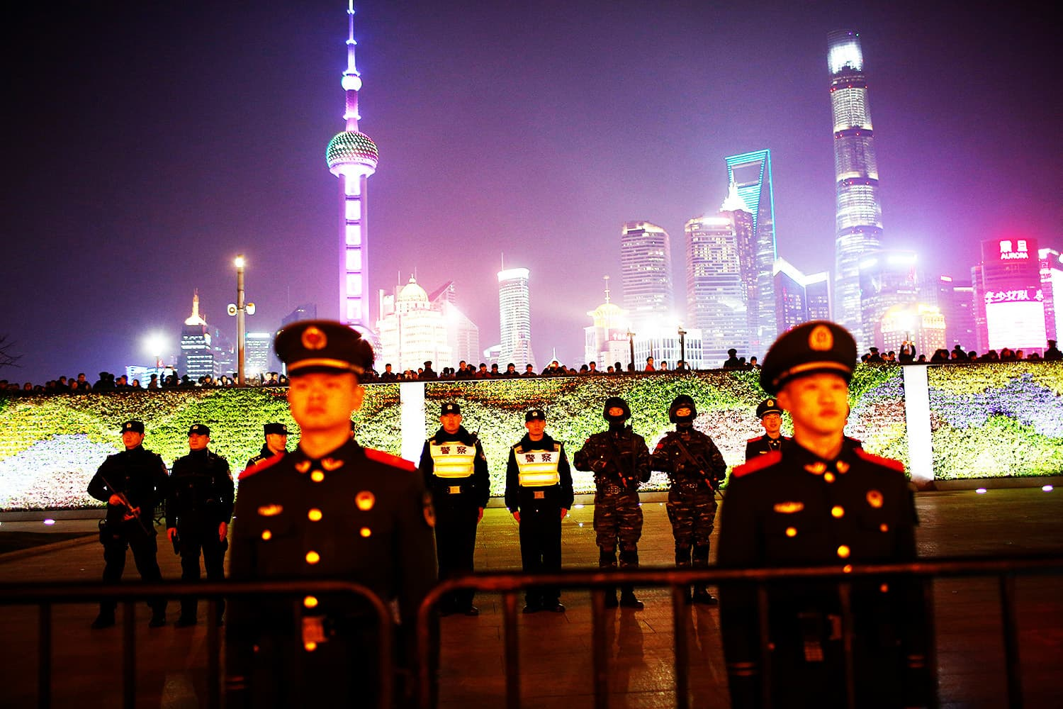 Police officers stand guard at the location where a stampede incident occurred during New Year celebrations two years ago, on the Bund in Shanghai, China.—Reuters