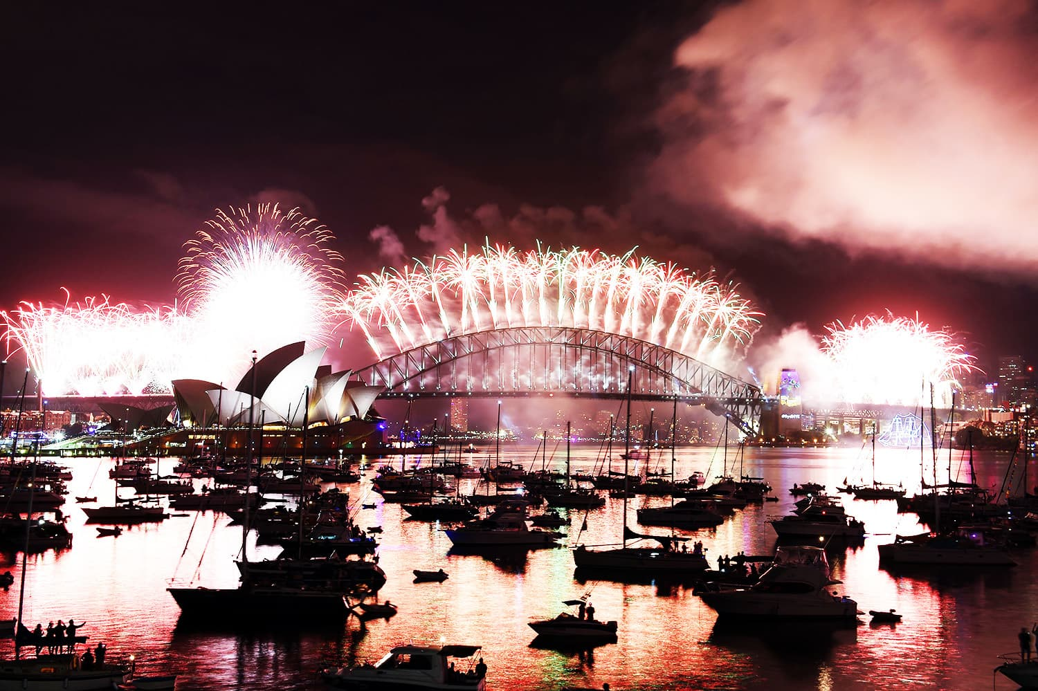 New Year fireworks illuminate the sky over the iconic Opera House and Harbour Bridge in Sydney.—AFP
