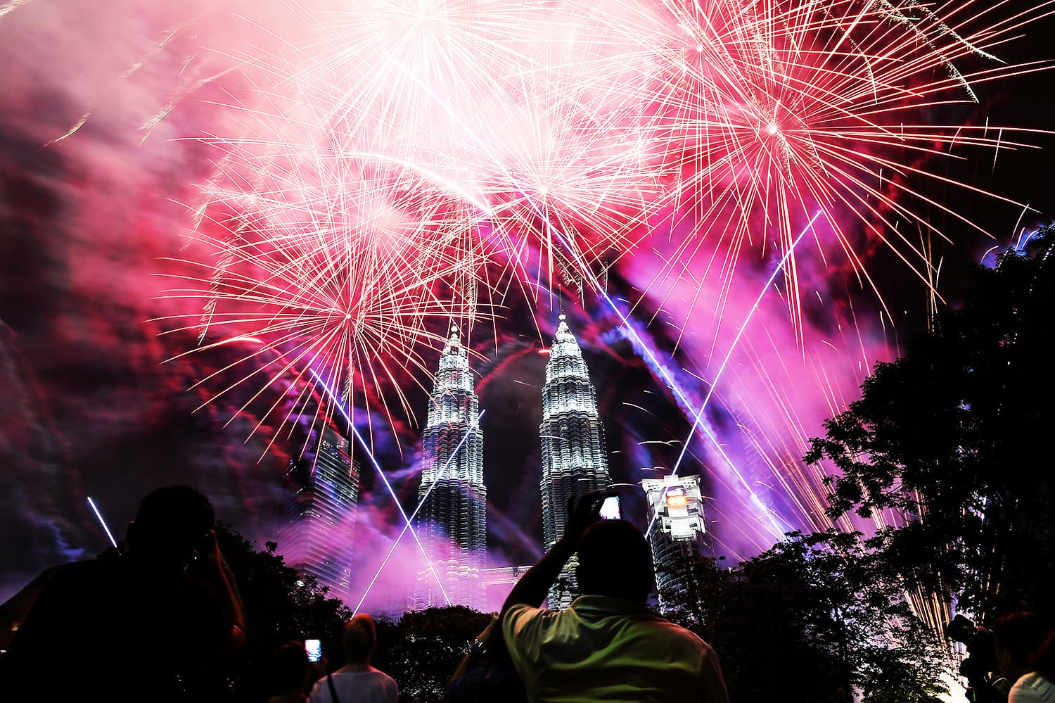 Fireworks illuminate the sky near Malaysia's landmark Petronas Twin Towers during the New Year celebrations.—AFP