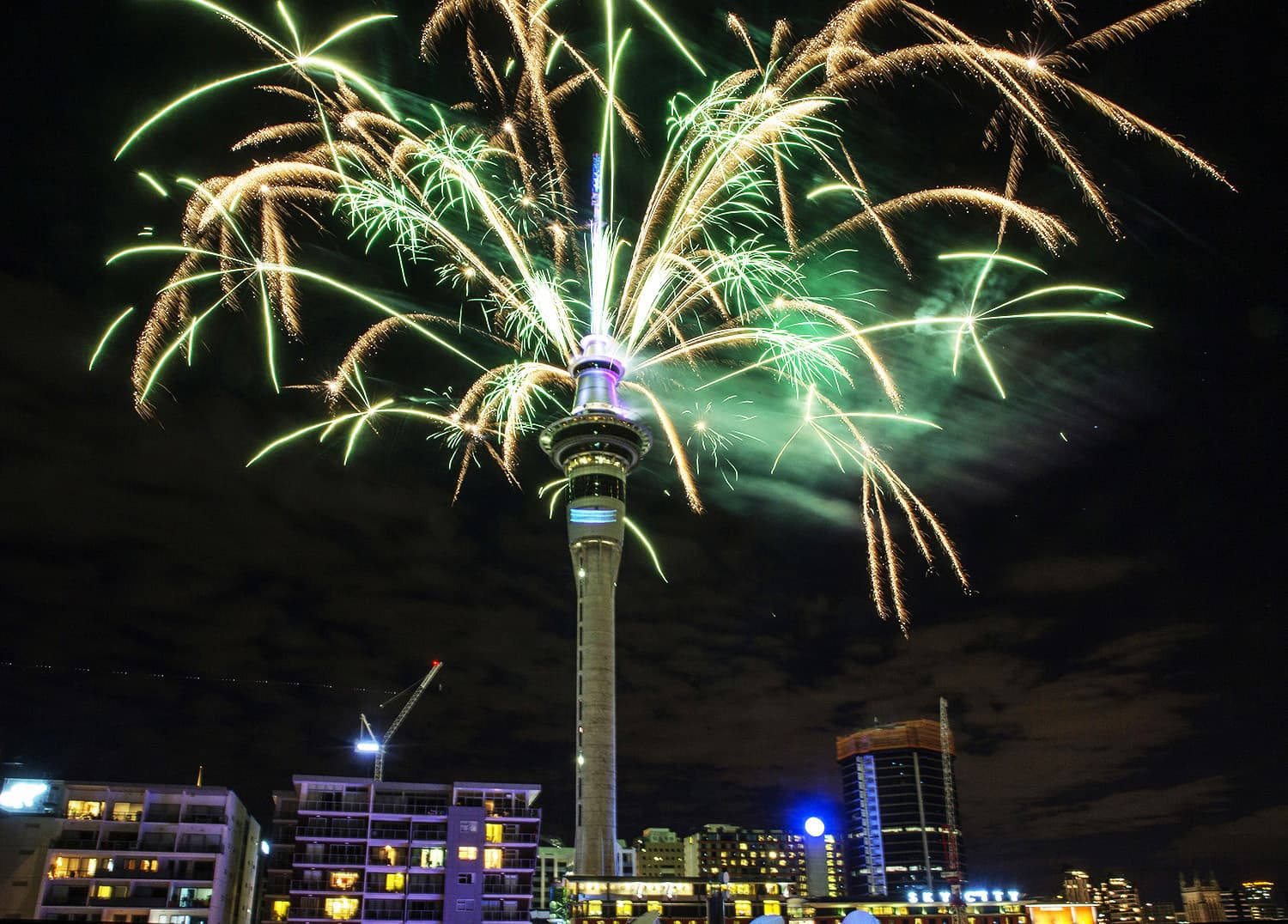 Fireworks explode off Auckland's Sky Tower as the new year is welcomed to New Zealand.—AP