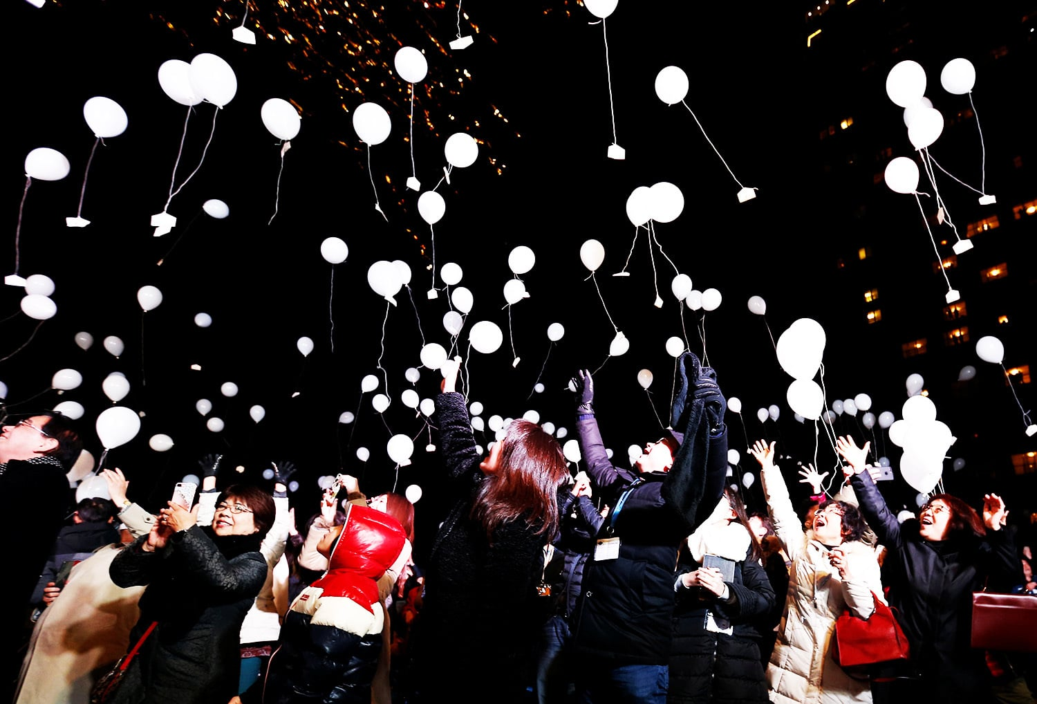 Revellers release balloons as they take part in New Year celebrations in Tokyo, Japan.—Reuters