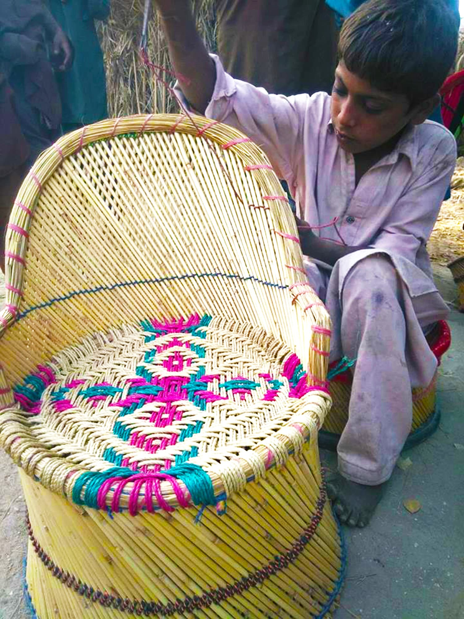 A boy shows the *moorho* that he made.