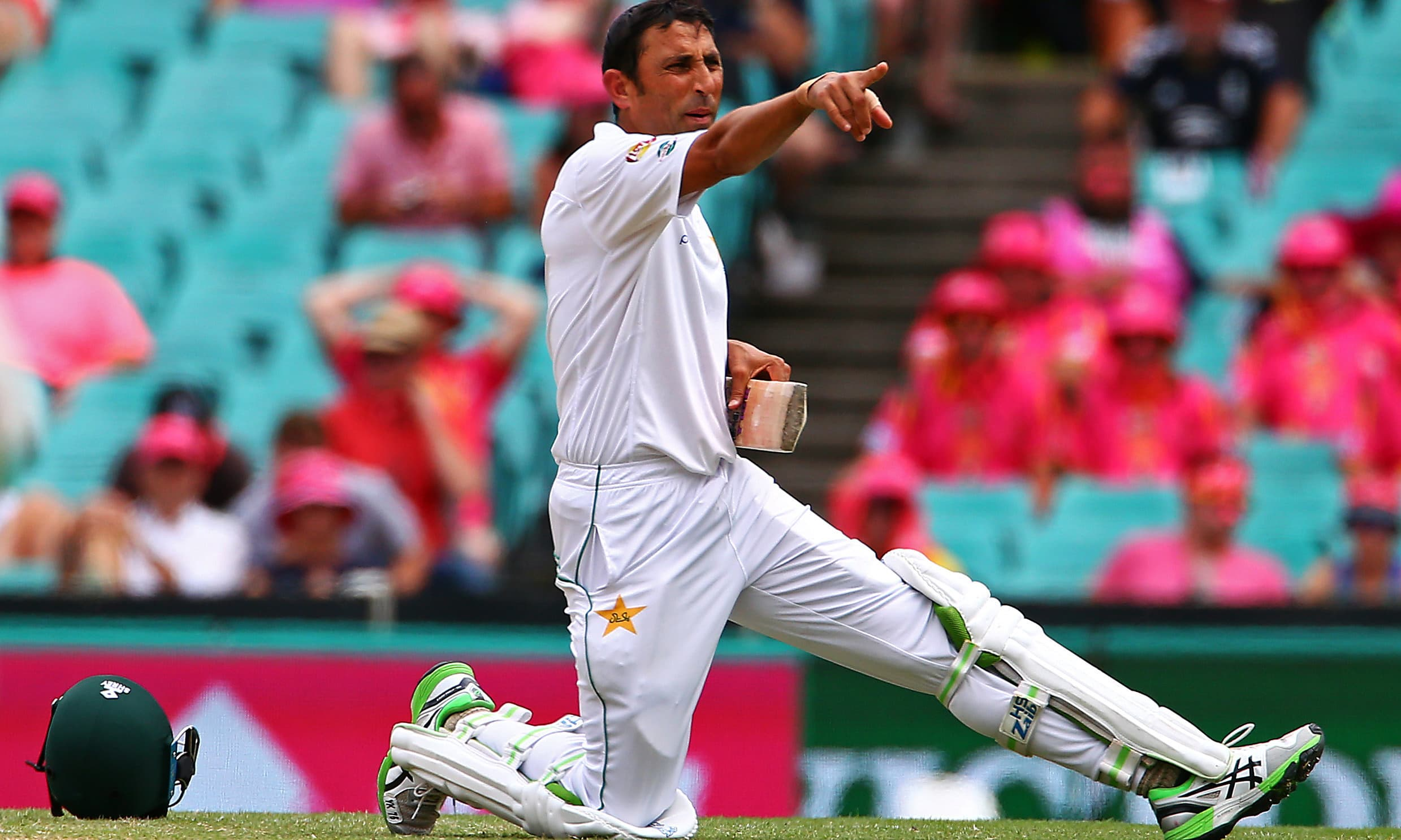 Younis Khan yells to team mates after damaging his bat. —Reuters