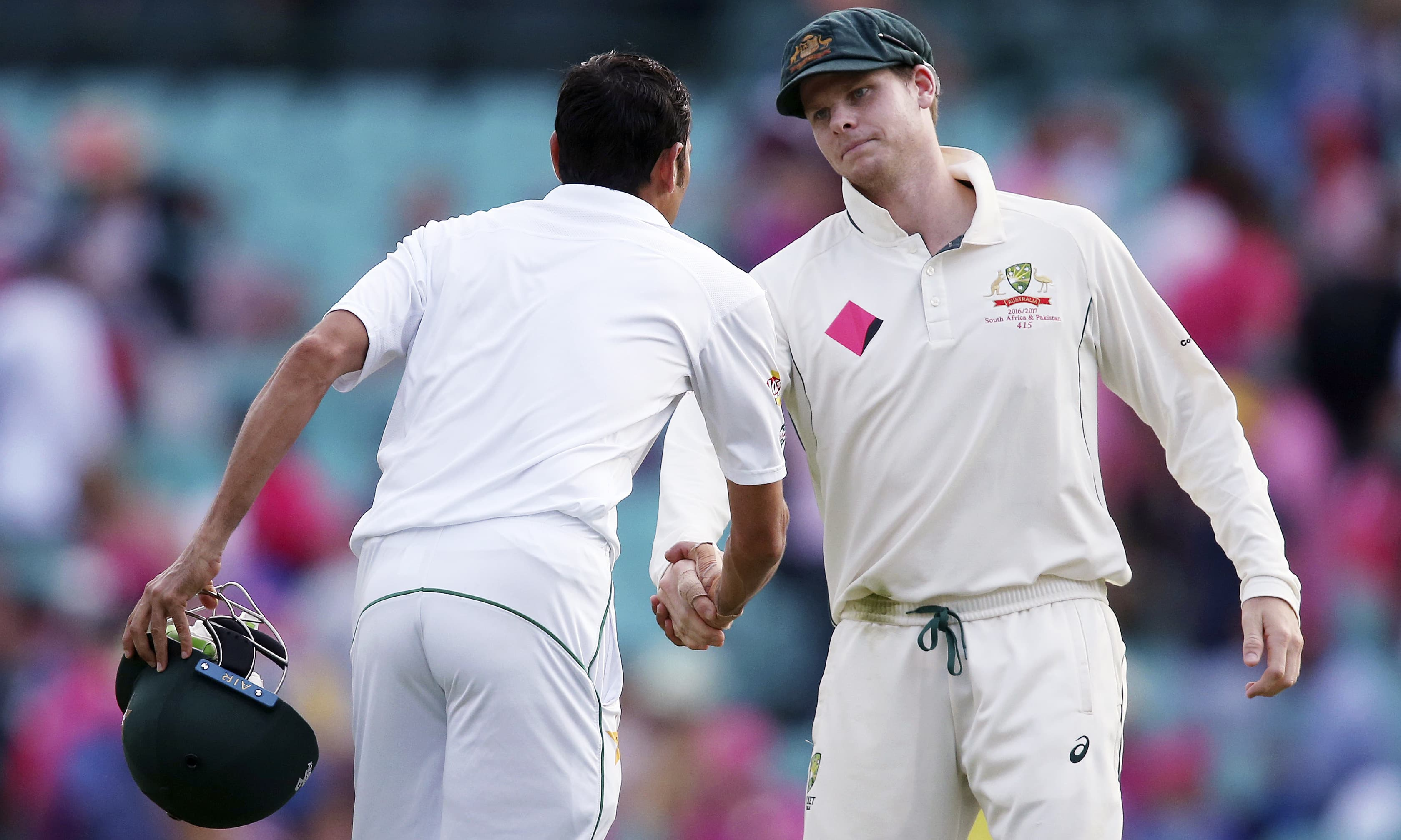 Steven Smith congratulates Younis Khan at the end of the day's play. —AP