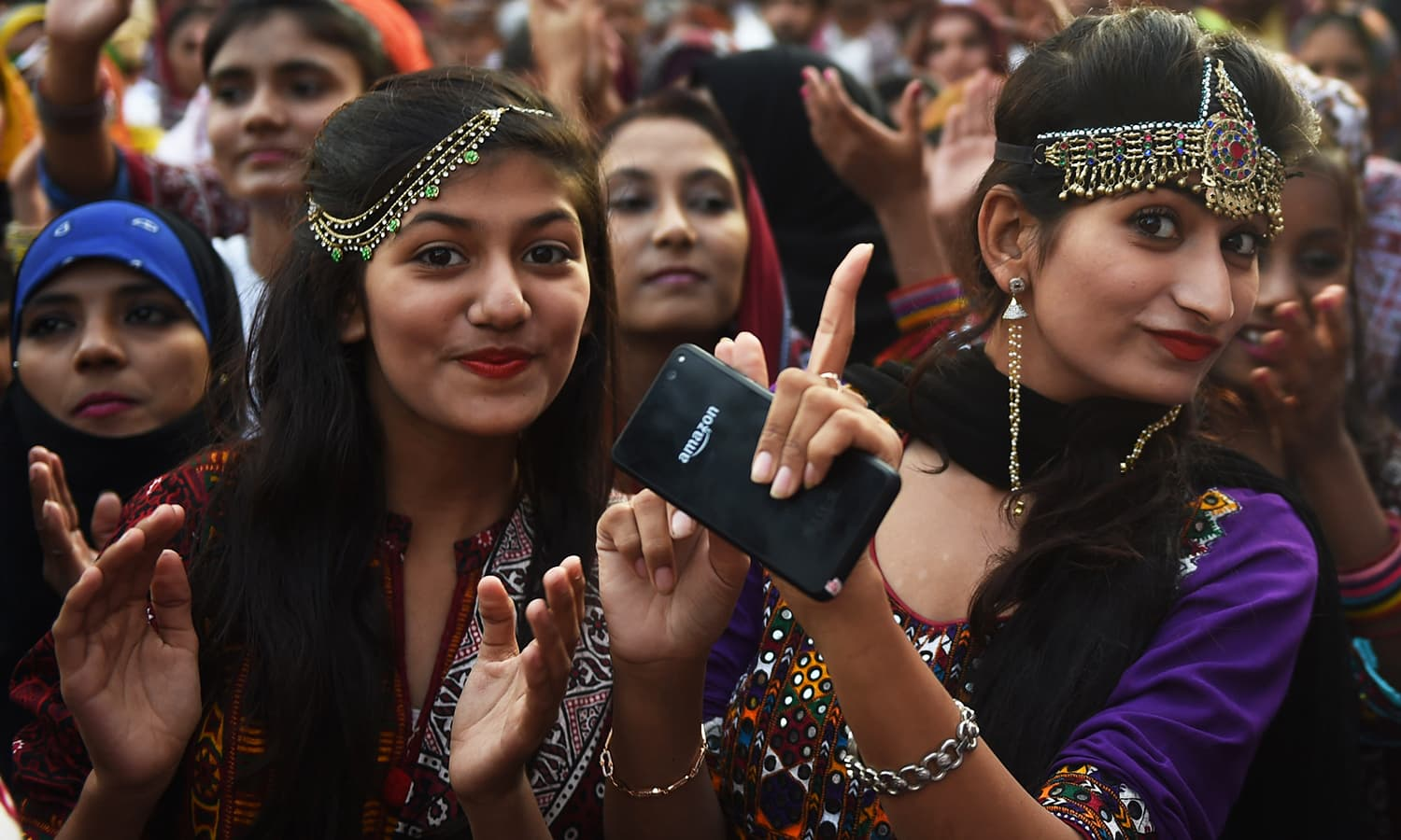 Young Sindhi women pose as they attend a Sindh Cultural festival in Karachi.— AFP