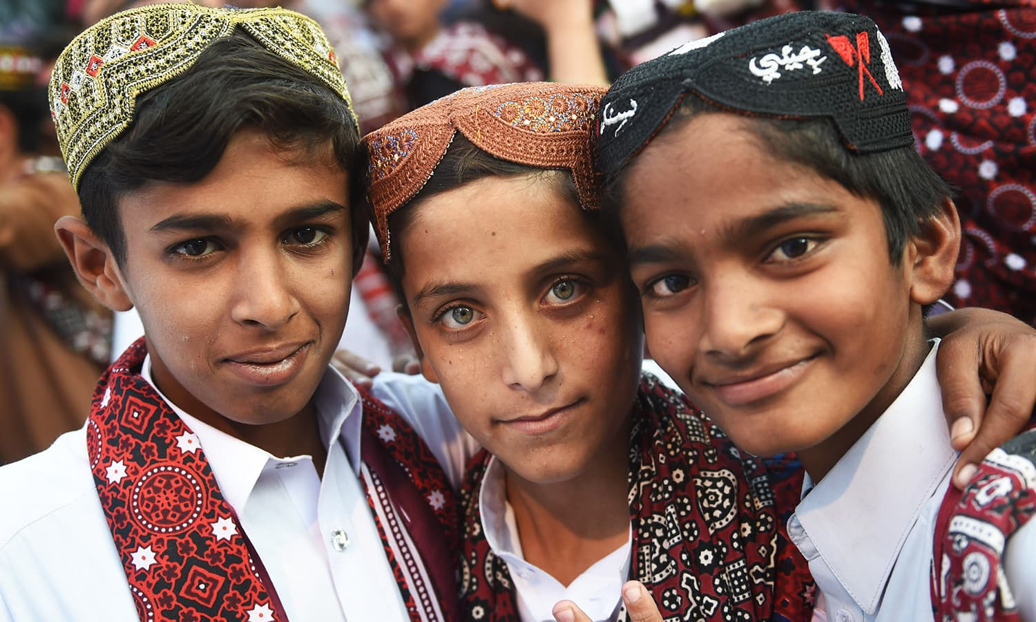 Sindhi children pose as they attend a Sindh Cultural festival in Karachi.— AFP