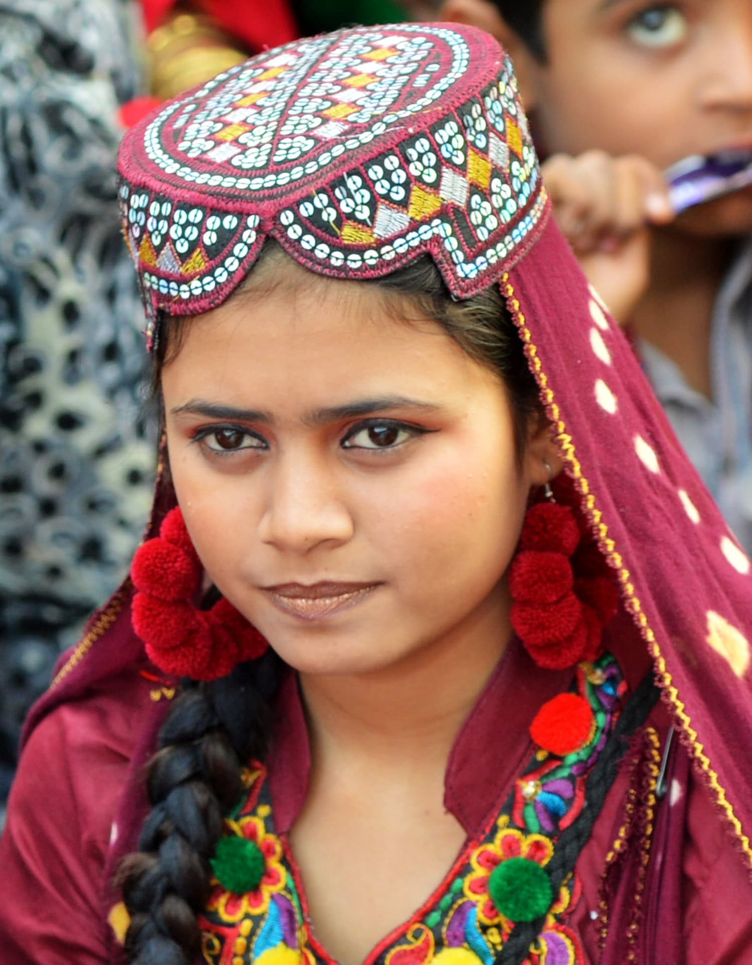 A young Sindhi woman looks on as she attends a Sindh Cultural festival in Karachi.— AFP