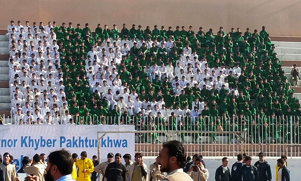Students wearing green and white clothes make a national flag at the concluding ceremony of FATA Youth festival in Peshawar | Shahbaz Butt, White Star