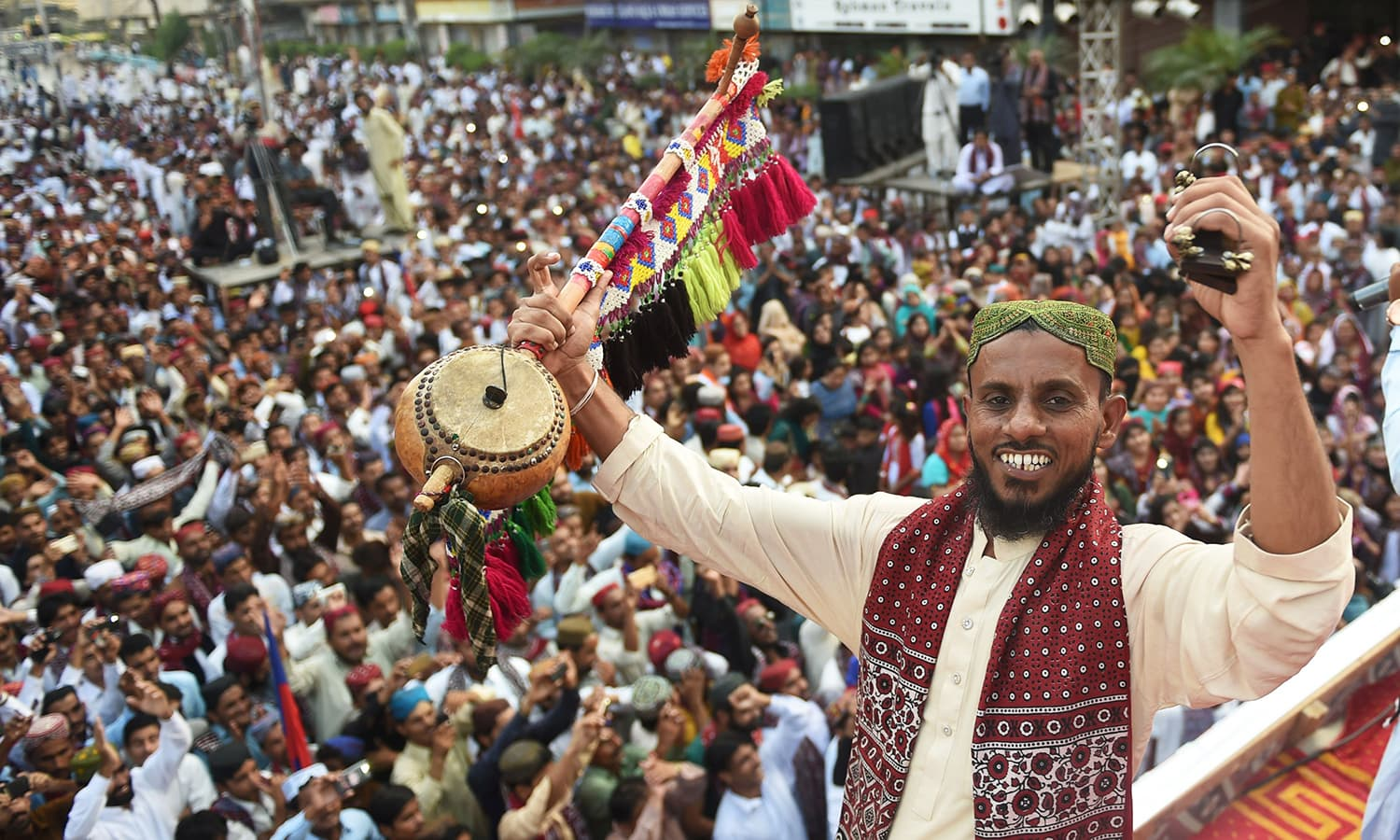A Sindhi folk singer wearing traditional Sindhi cap and Ajrak performs during a Sindh Cultural Day festival in Karachi.— AFP