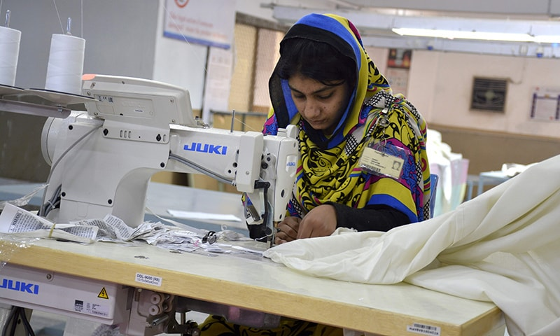 A Pakistani machinist works at a textile factory in Faisalabad.─AFP