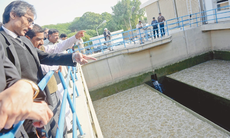 JUSTICE Mohammad Iqbal Kalhoro inspecting a water filtration tank at the Dhabeji Pumping Station.—Fahim Siddiqi / White Star