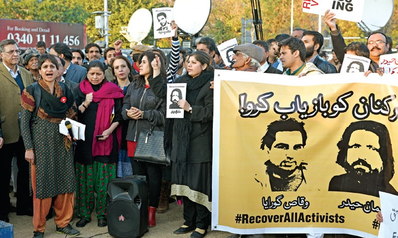 Members of civil society demand the return of academic Salman Haider and other activists at a demonstration outside the National Press Club on Tuesday. — Photo by Tanveer Shahzad