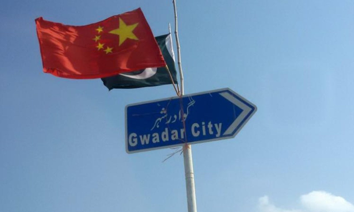 The Chinese flag flies next to Pakistan's flag on a sign along a road towards Gwadar | Syed Raza Hassan, Reuters