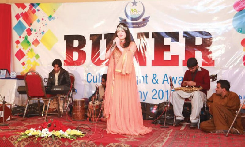 A Pashto singer performs at a musical show in Peshawar on Wednesday. —Dawn