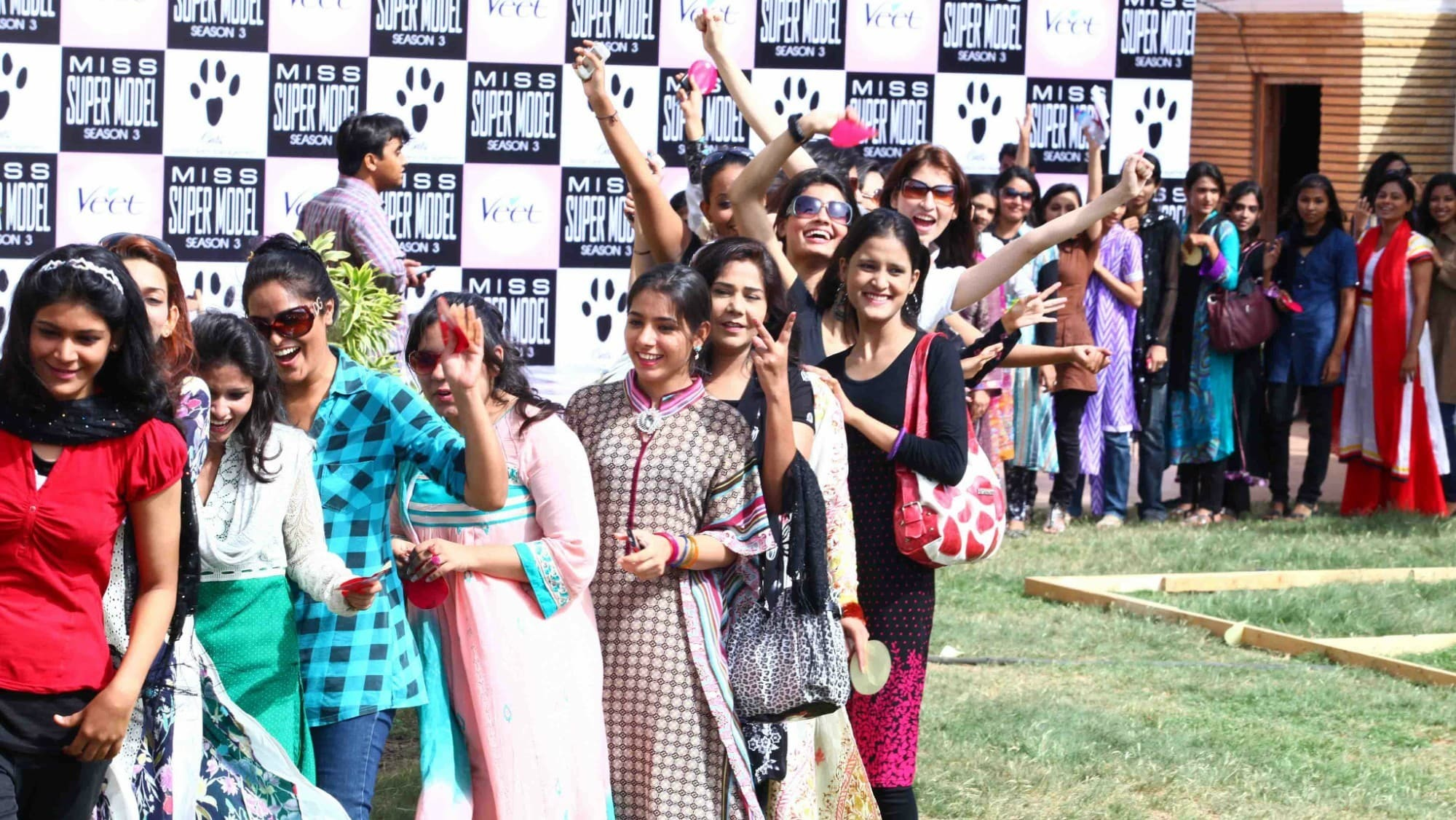An excited Abeer Rizvi peeks out from a line of hopefuls at the Veet Miss Super Model Contest Season 3