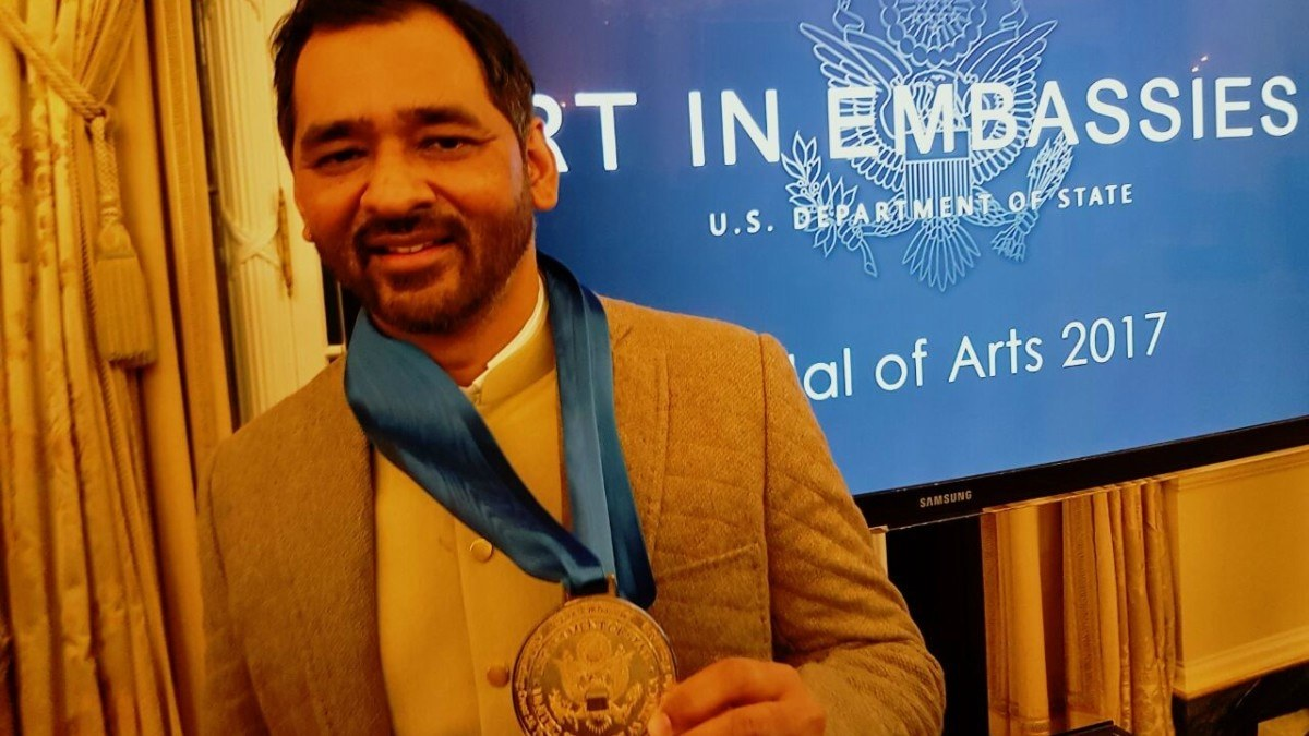 Imran Qureshi at the ceremony at the State Department's historic Benjamin Franklin Room in Washington D.C