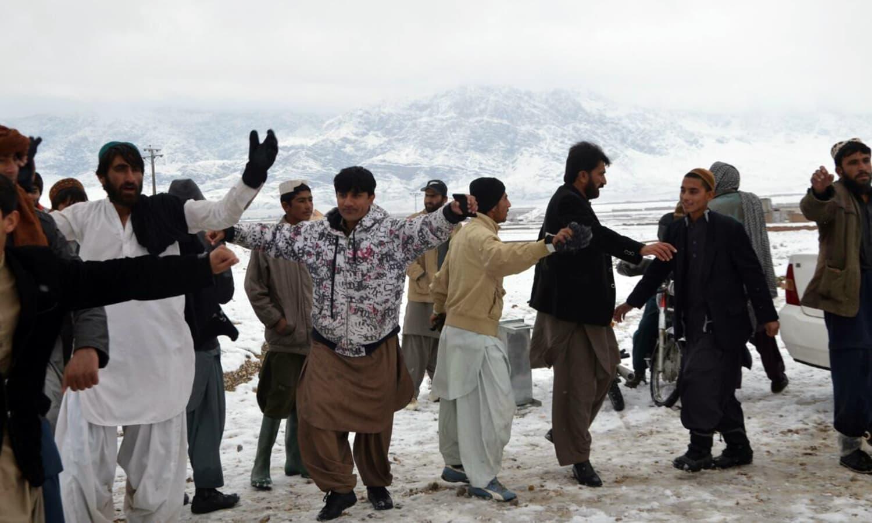 Men dance to express their jubilation.— Photo by Asmatullah Kakar