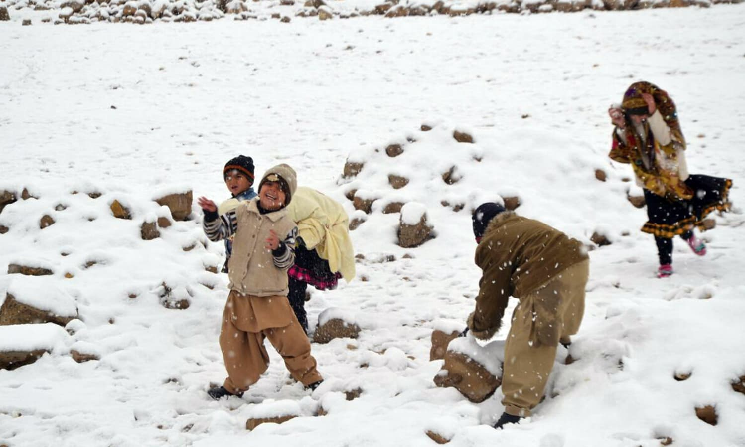 Children are overjoyed with the change in weather.— Photo by Asmatullah Kakar