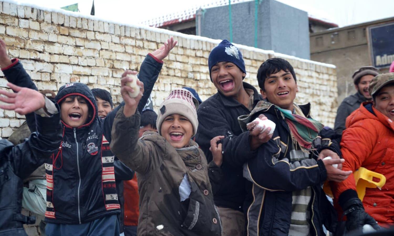 Children pose with snowballs.— Photo by Asmatullah Kakar