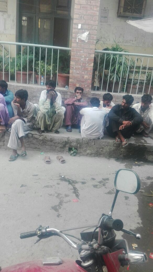 Some of the detainees waiting to give evidence in court.— Photo by Syed Yasir Shah Tirmizi