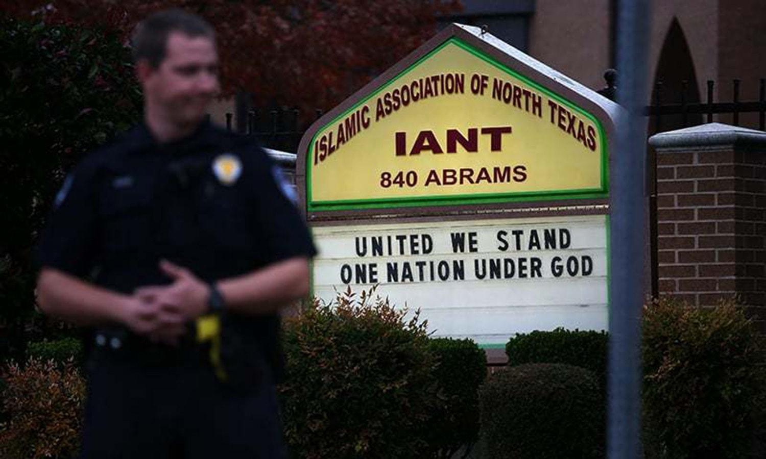 A policeman stands guard in front of an Islamic centre in Texas during a protest.—AFP