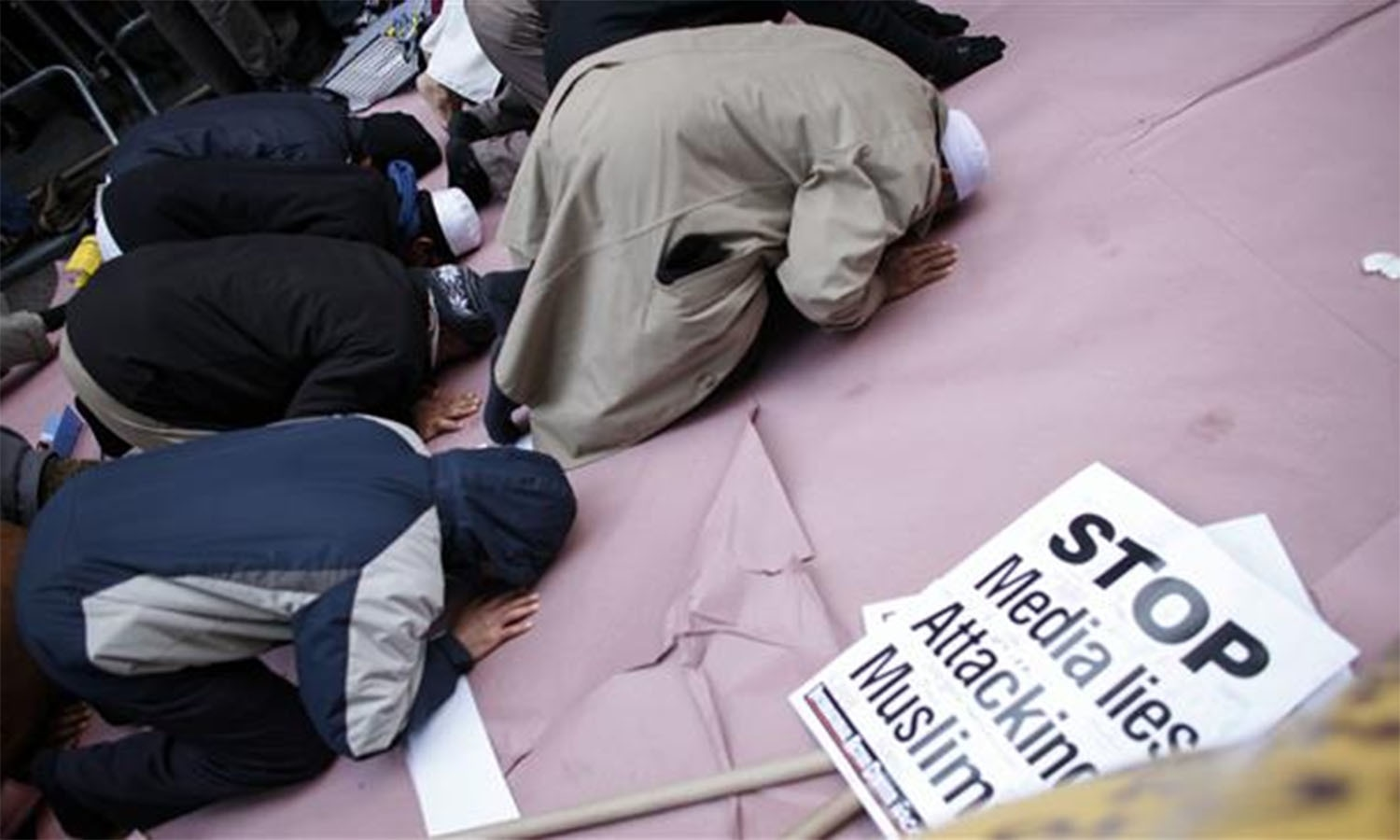 A group of Muslims prays at a rally outside Trump Tower.—AFP
