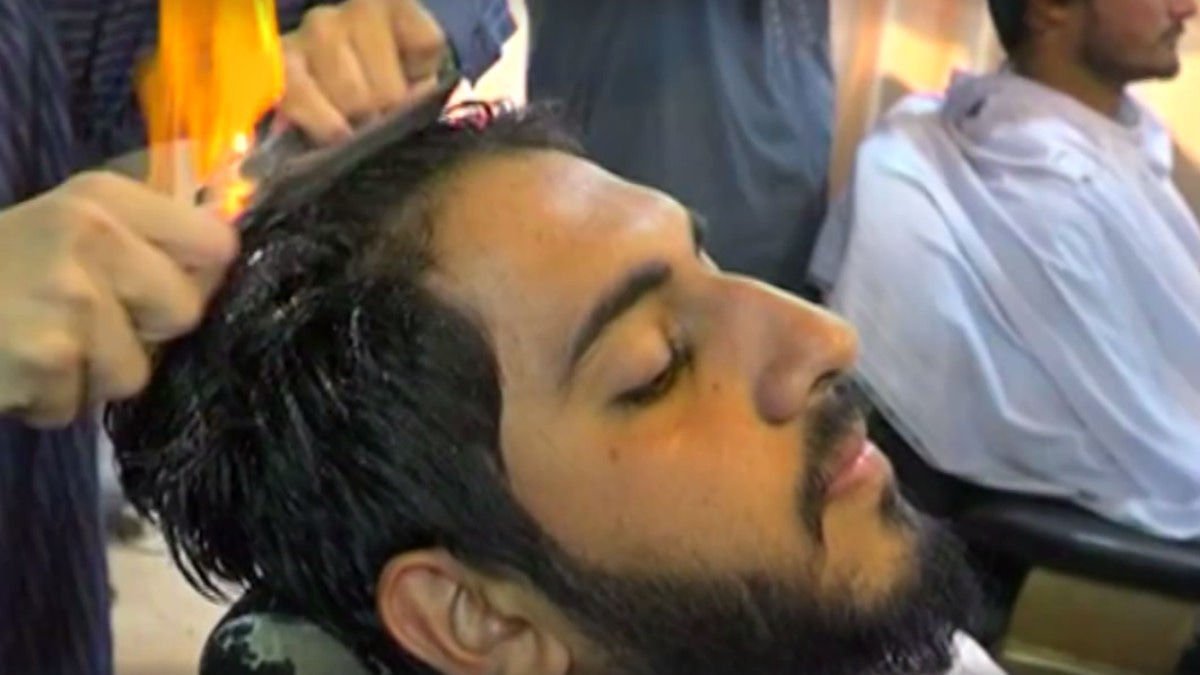 This barber in Bahawalpur will literally set your hair on fire