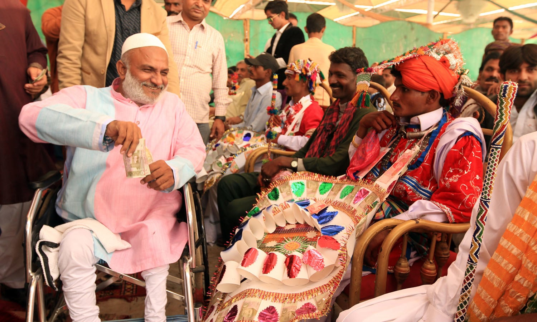 Lead organiser Raju Baba meets the couples' families.