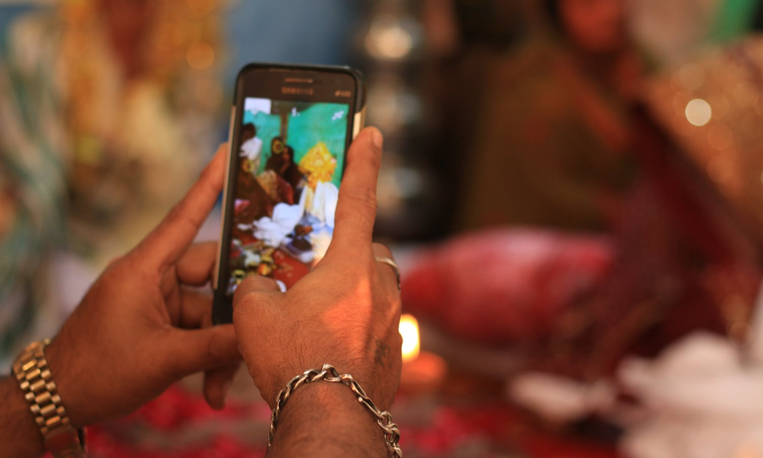 A guest snaps a photo of his friend before his marriage.