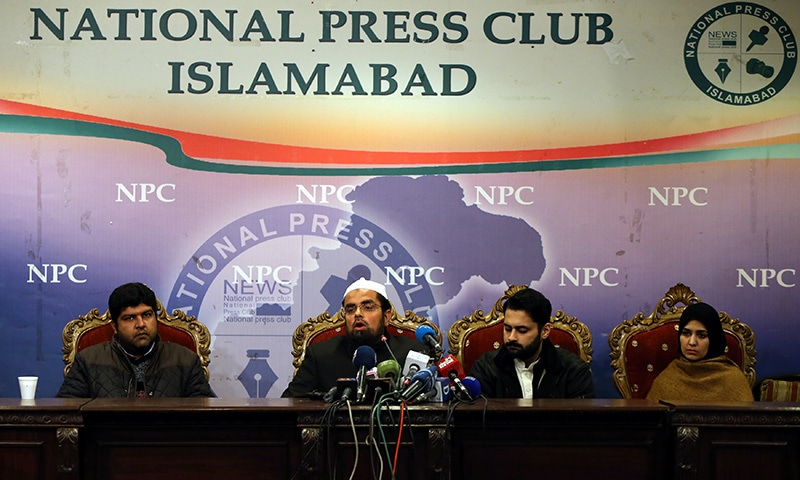 Mufti Faisal Khushi speaks as Mesha Saeed (R), wife of missing social activist Waqass Goraya, Jibran Nasir (2ndR) a human rights lawyer and Faraz Haider (L), brother of missing social activist Salman Haider, listen during a news conference. — Reuters