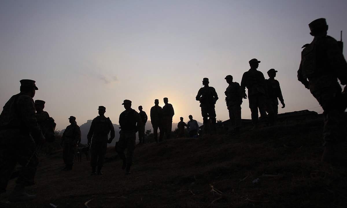 Pakistan army soldiers gathered at a forward area post on the Line of Control | AP