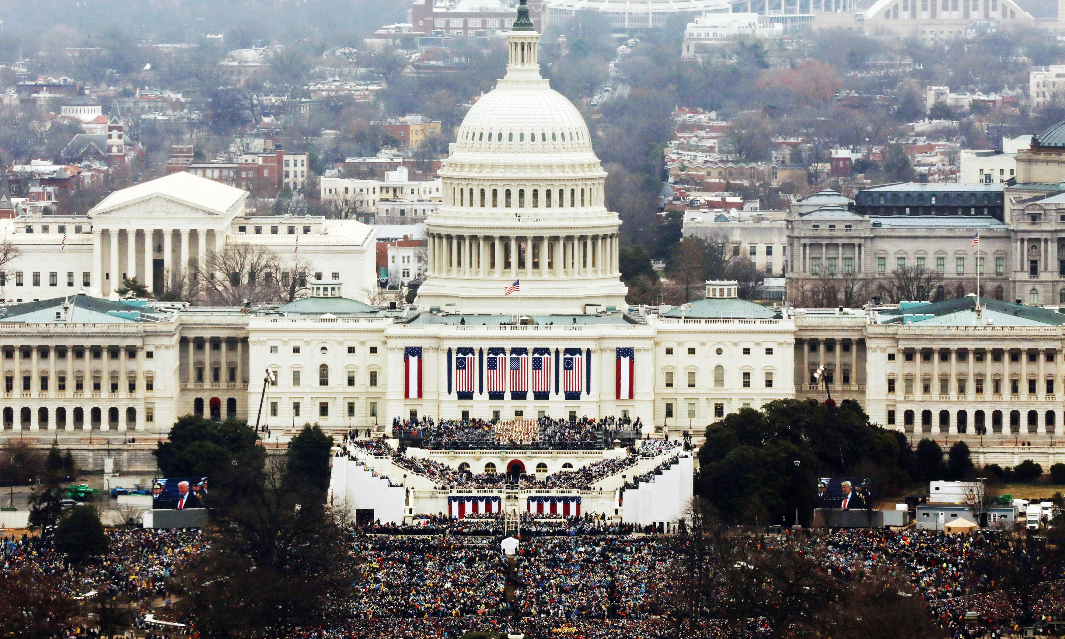 Attendees partake in the inauguration ceremonies to swear in Donald Trump as the 45th president of the United States. -Reuters