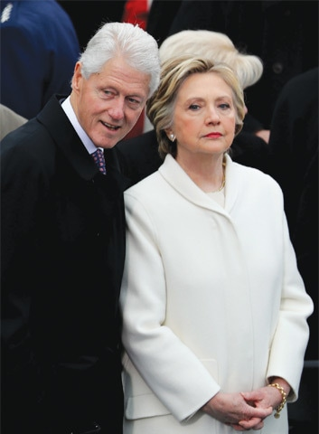 FORMER President Bill Clinton and former Democratic presidential nominee Hillary Clinton stand on the West Front of the US Capitol Building in Washington, DC on Friday.—AFP
